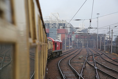 60017 leads 1Z26 out of Trafford Park with Old Trafford visible ahead - 16/12/17.