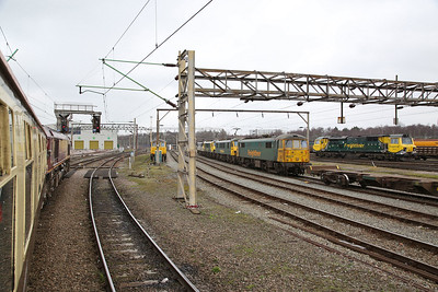 66002 pauses in Crewe Basford Hall yard on 1Z31 .... Freightliner loco's 86607, 86628, 90046, 90042, 90047, 70013 can all be seen - 11/03/17.