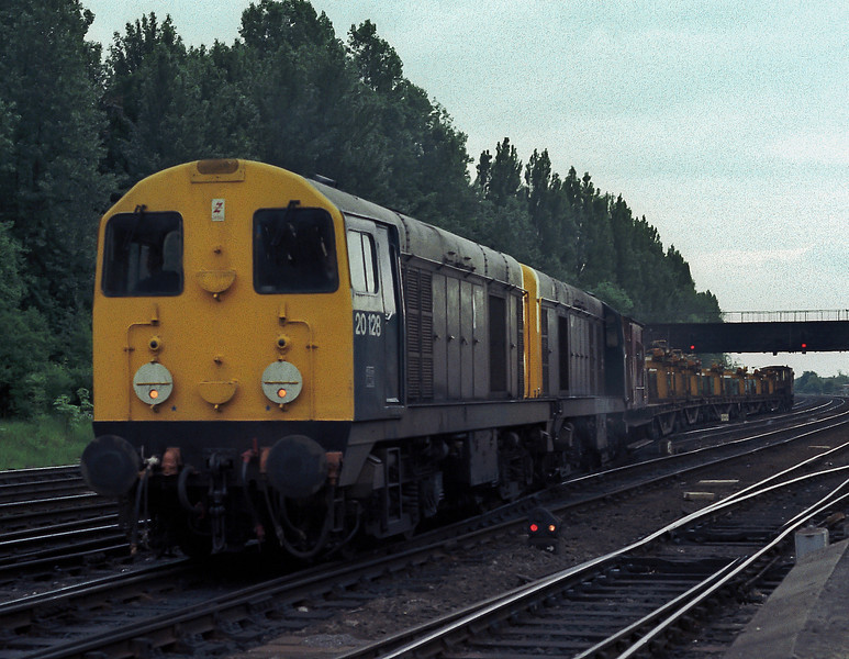 20128 and 20210 head for the freight avoiding lines at York with a train of work equipment on 11 June 1985