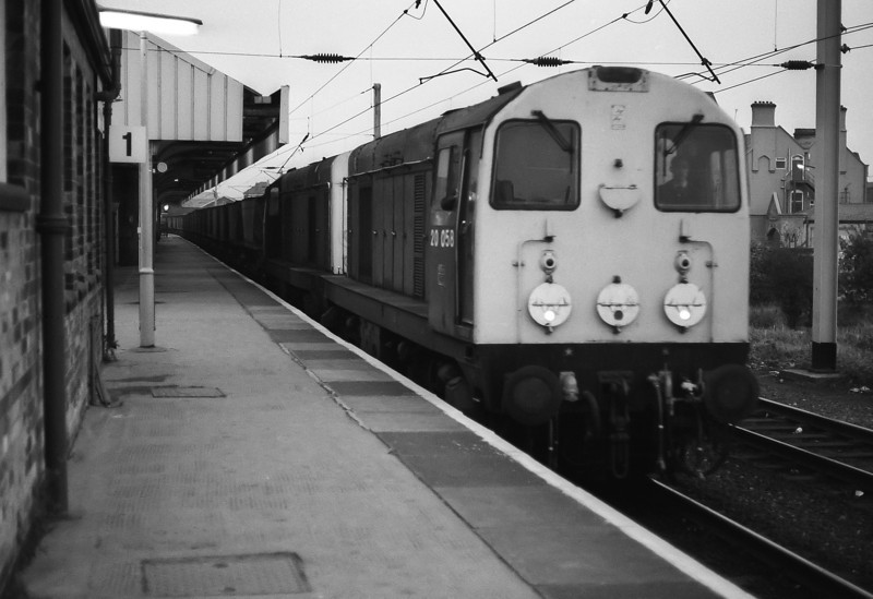 As darkness starts to fall 20058 and 20087 roll through Warrington Bank Quay with a merry-go-round coal service for the nearby Fiddlers Ferry power station on 30 September 1985