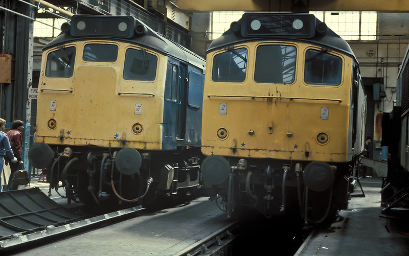 25034 (left) and 25286 display the different front end treatments of the class in Derby Works on 2 June 1984