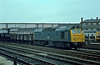 25180 runs past the loco works at Derby with a load of 4 wheel wagons on 24 November 1982
