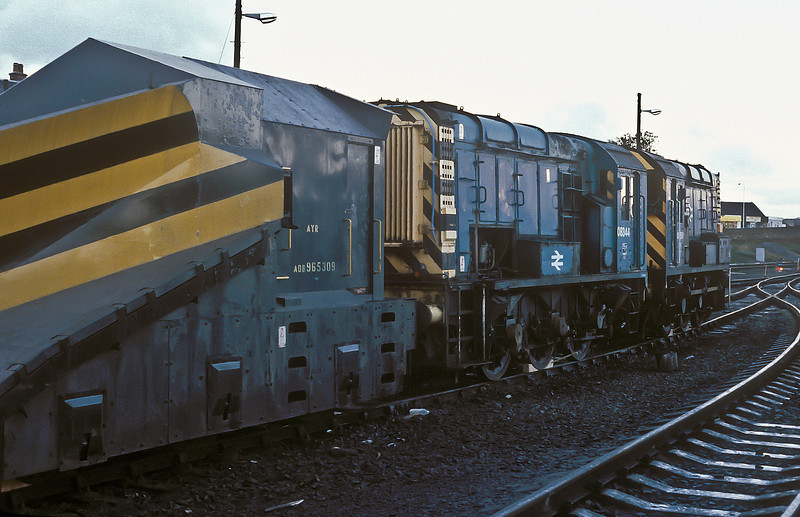 Withdrawn 08344 sits next to the snow plough alongside active 08591 at Ayr on 10 November 1985