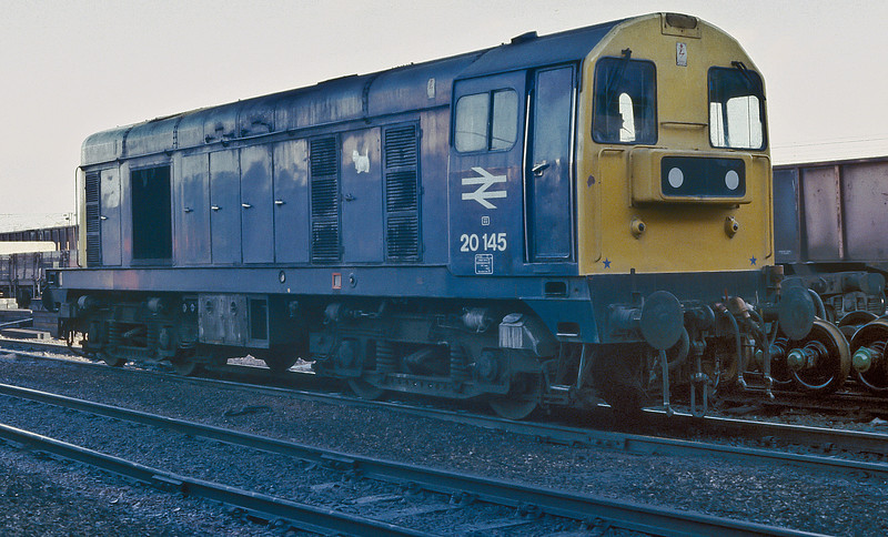 20145 sits alongside the wagon repair roads at Motherwell on 10 November 1985
