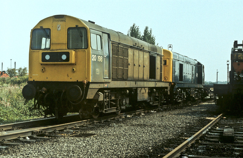 Displaying very different standards of cleaning 20198 and 20142 are at Toton depot on 21 August 1984