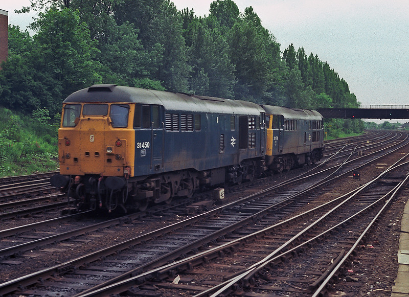 'Skinhead' 31450 and 31176 head south from York on 11 June 1985