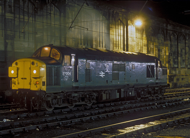 37004 idles away in the station holding sidings at Carlisle on 10 November 1985