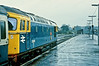 33025 'Sultan' is seen at Fareham with a Bristol service on a very wet 23 November 1982