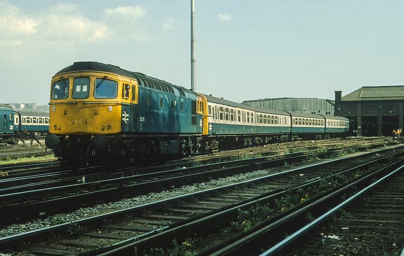 33011 shunts a 4VEP at Brighton Lovers Walk depot on 2 May 1987