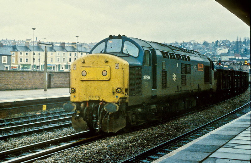 37180 heads east at Newport with a string of 4 wheel coal wagons on 23 November 1982