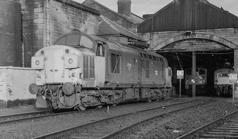 37112 has gained all yellow noses as it waits at Motherwell TMD for its next duty on 27 November 1982