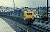 37187 and a string of 21 ton coal wagons run through Newport on 23 November 1982