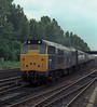 31168 approaches York on 11 June 1985 with a train consisting of coaches for repair at the nearby Works