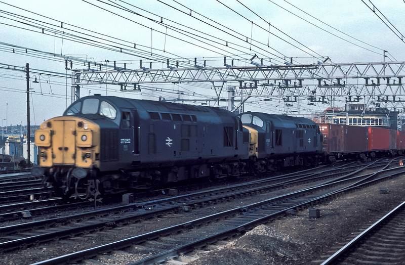 37052 and 37103 pass Stratford with a freightliner on 8 March 1985