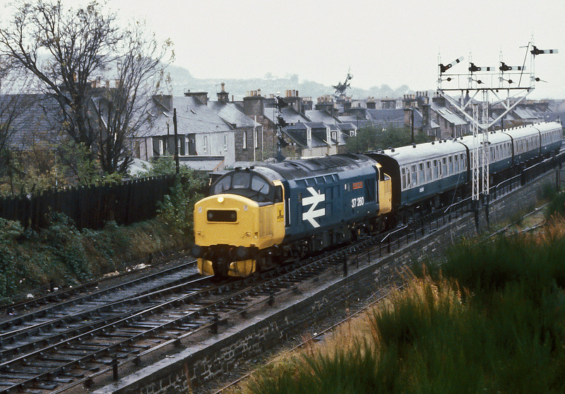 37260 'Radio Highland' runs into Inverness on a grey and wet 9 November 1985 morning with an early train from Kyle of Lochalsh