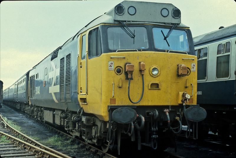 50043 sits in Fratton Yard on empty stock in May 1984