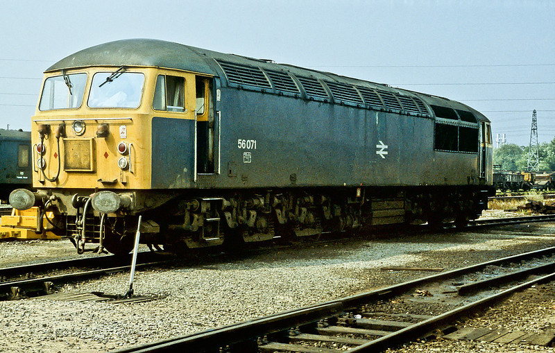 Waiting for its next duty hauling merry go round trains of coal 56071 is at Toton depot on 21 August 1984
