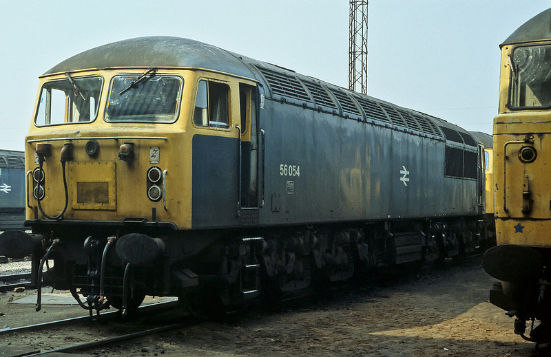 56054 sits in the sun outside Toton shed on 22 August 1984