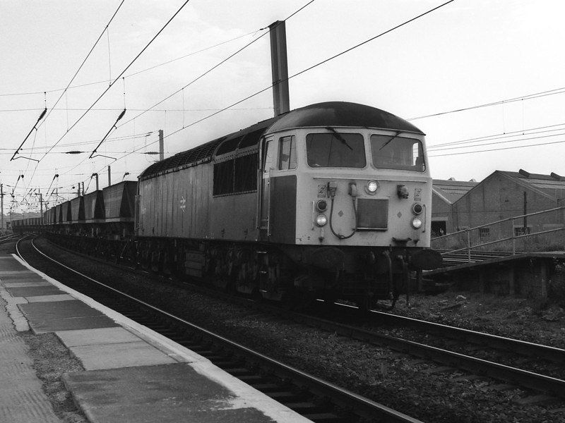 56077 heads northbound through Warrington Bank Quay with MGR empties on 30 September 1985
