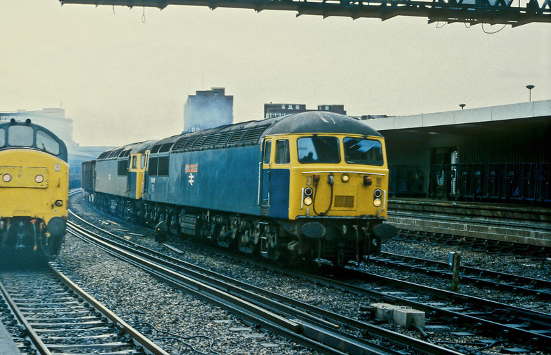56037 'Richard Trevithick' and 56041 lead a Llanwern ore train through Newport on 23 November 1982 heading back to Port Talbot