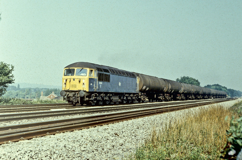 56043 heads west through Twyford with a train of tank wagons on 26 August 1983