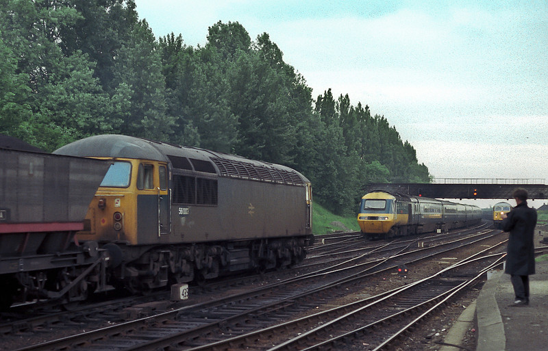 A busy time at York as 56003 heads south with an MGR train as 56092 waits to head north. In the meantime an HST heads for the station on 11 June 1985