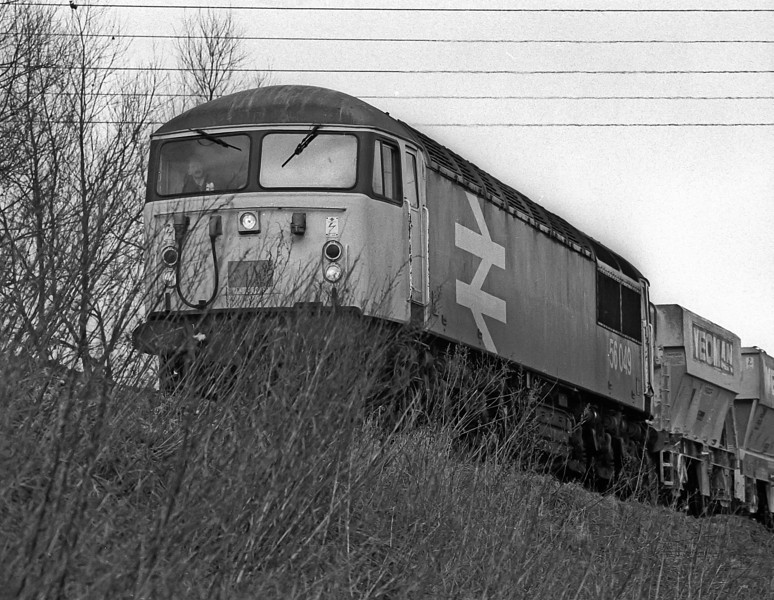 56049 drops down the bank through Dilton Marsh on its way to Westbury on 24 january 1986