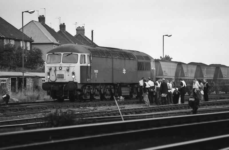 56023 heads south through York with a loaded merry-go-round service on 2 October 1985