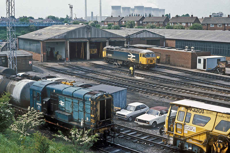 56095 is stabled outside the small maintenance shed at Knottingley on 4 June 1985; 08243 in the foreground was not officially withdrawn until the following February and was cut up by early 1988
