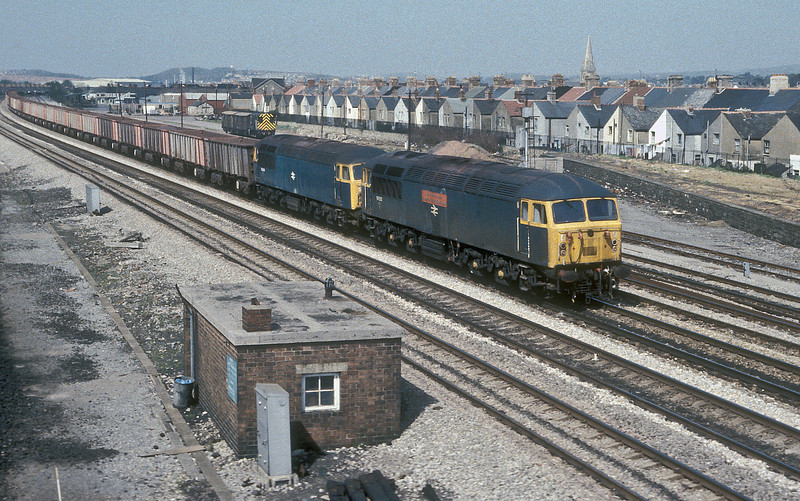 With another load of iron ore for Llanwern 56032 'County of South Glamorgan' and 56044 head toward Cardiff on 24 April 1985