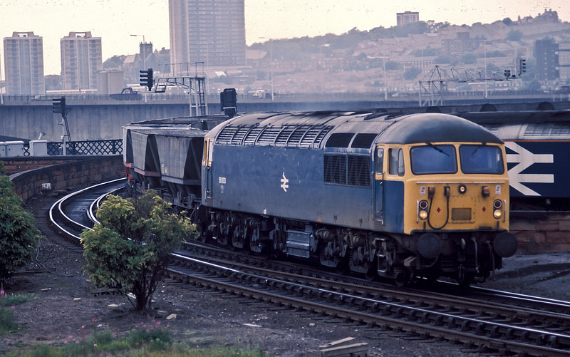 56003 passes the rear of Gateshead depot in July 1988 with a rake of empty coal wagons