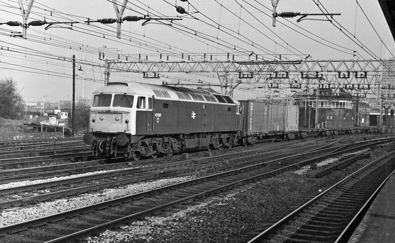 With trademark Stratford white roof 47008 passes its home station with a freightliner service on 1 March 1984