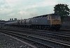 47377 heads south through the station roads at York with a train of cement tanks on 11 June 1985