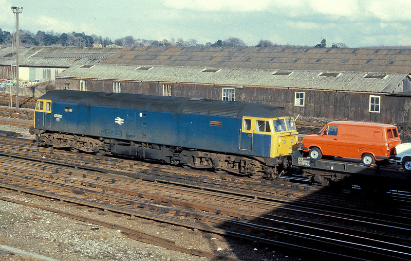 47352 is heading into the yard at Eastleigh with a trainload of new Ford Transit vans on 5 March 1985