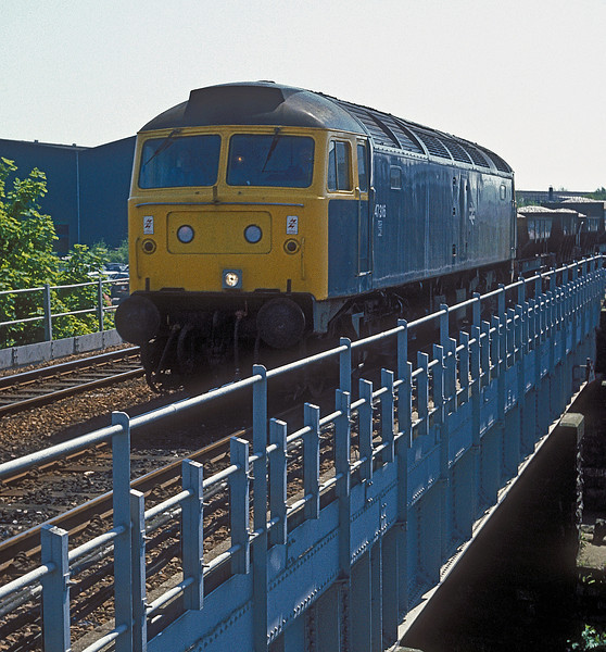 47316 runs past the rear of Chesterfield station with a ballast train on 3 June 1985