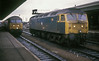 47608 waits in the middle roads at Reading to take over from the service seen entering the station on 30 March 1986