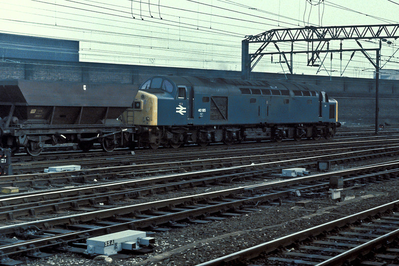 40185 passes south through Crewe station with a train of coal empties on 29 October 1982