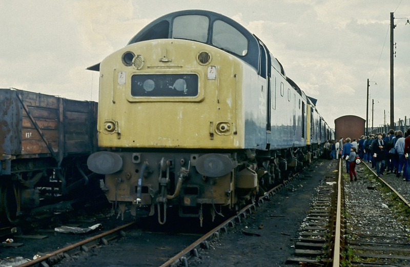 40163 presents a sad sight as it heads a line of Class 25 locos in the scrap line at Derby Works on 2 Jume 1984