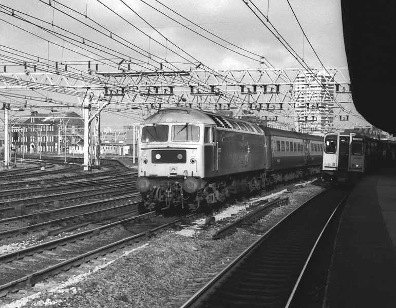 47573 heads through Stratford with an up express from Norwich on 1 March 1984 passing 315844 on a local service