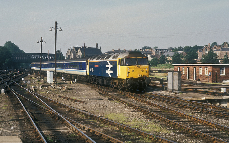 47535 has a complete Trans Pennine livery rake in tow as it runs into York on 6 July 1987