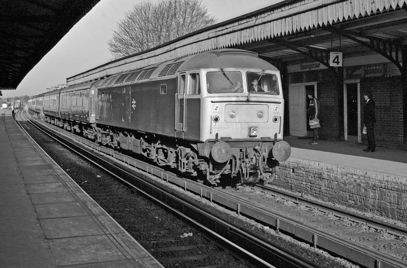 47123 arrives at Basingstoke with a steam-heated inter-regional service on 24 April 1985; I recognise the driver as being a South West man but cannot identify the second man from his, rather prominent, boots!