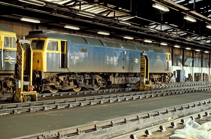 Undergoing maintenance inside the running shed at Eastleigh on 24 February 1985 is 47296
