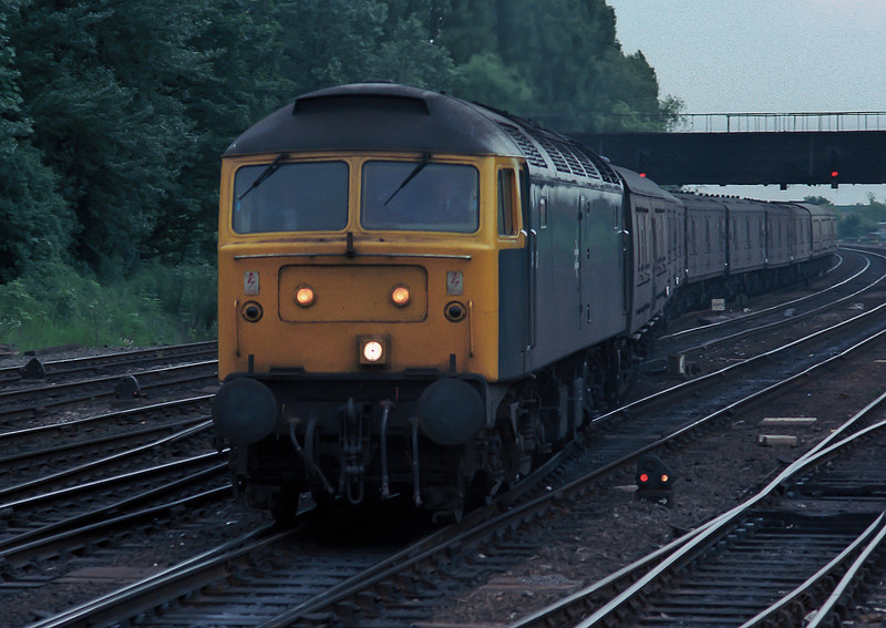 47313 is crossing over to the freight by-pass lines at York on 11 June 1985