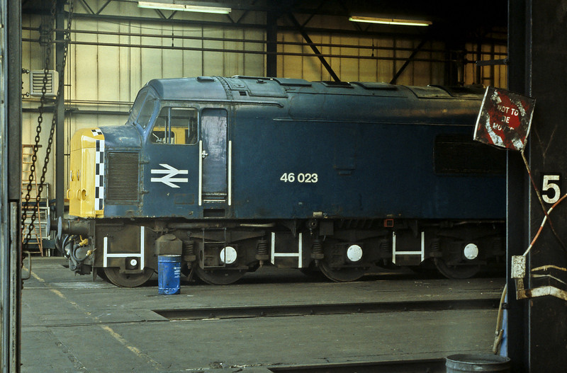 In 1984 46009 was destroyed in a staged crash with a nuclear flask wagon amid much publicity. 46023 (which had been renumbered on paper to 97402) was prepared as the back up locomotive for the test and was photographed at Toton depot still with the markings for the filming applied to the nose and underframes, seen on 21 August 1984 a couple of months before the filmed 'crash' which destroyed its sister on the Old Dalby test track
