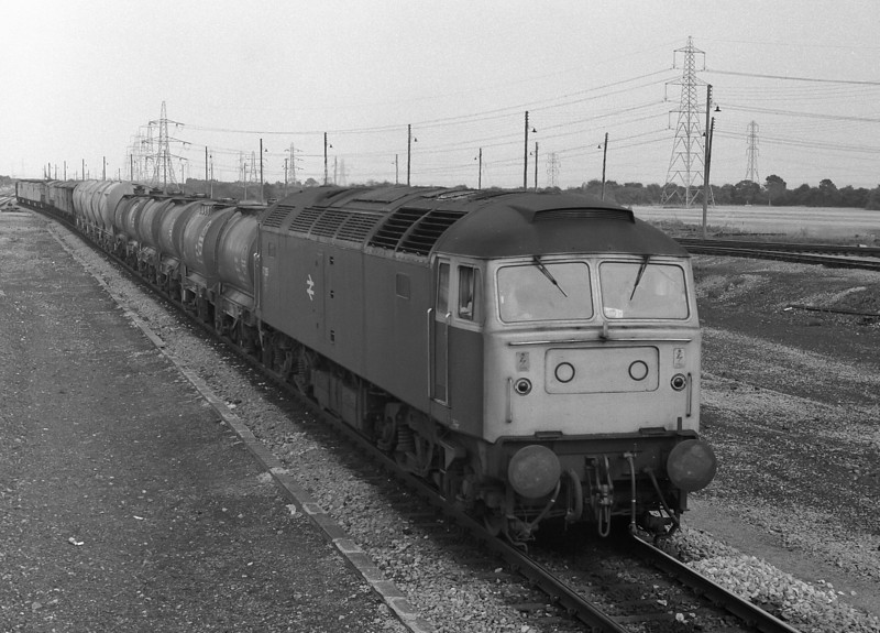 47235 heads through Severn Tunnel Jn with a mixed freight on 22 August 1983