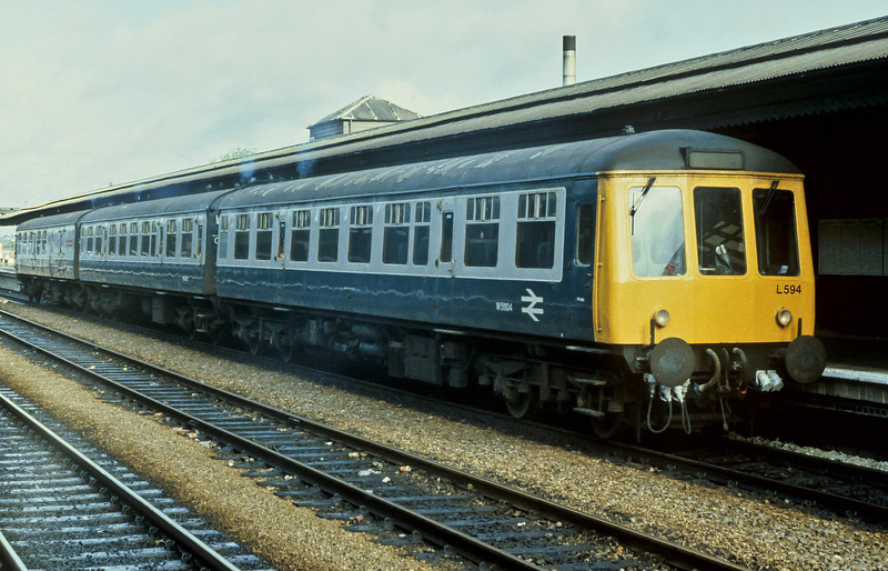 Class 119 set L594 is headed by W51104 as it gets underway at Reading on 2 June 1984