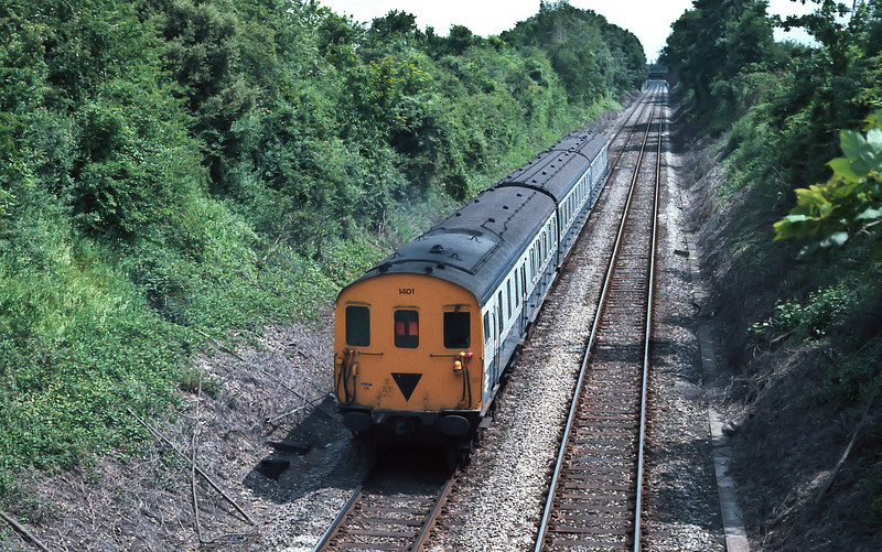 Class 204 1401 is seen leaving Fareham heading toward Swanwick with a Southampton-bound service in June 1985