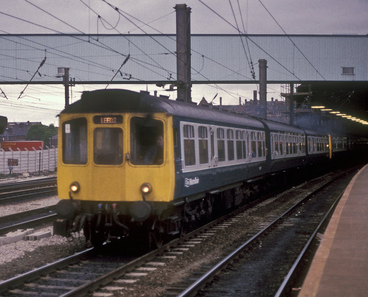 'Calder Valley' Class 110 unit led by E52085 departs from Preston on 25 May 1986