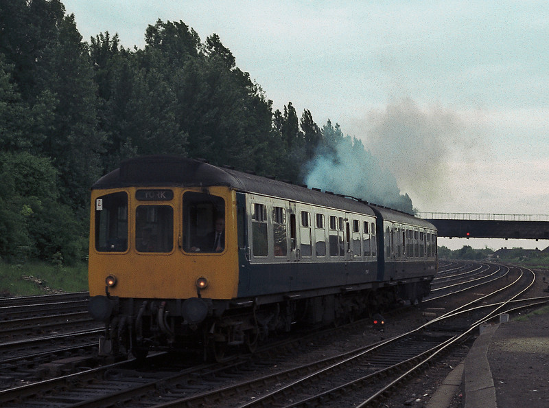 A two car Class 110 'Calder Valley' unit smokes its way into York on 12 June 1985