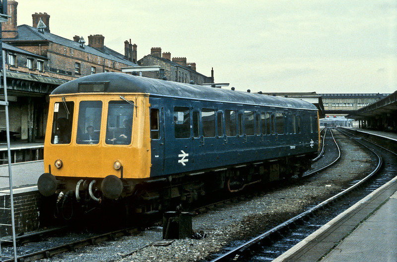 London Midland route learning saloon Class 122 TDB975227 is at Derby on 24 November 1984
